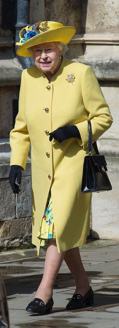 Queen Elizabeth II looked festive in a canary yellow coat and matching hat as she made her way into the church during Easter Sunday Service-2016 at Windsor Castle