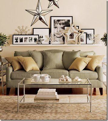 Tips for hanging artwork behind the sofa - I kind of like the long shelf with pieces leaning on it.