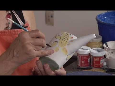 In this http://ceramicartsdaily.org Majolica Decorating Technique & Design video, Linda Arbuckle demonstrates how to make and decorate an ewer. #playinclay #ceramics #pottery #arteducation #video