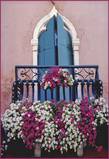 Balcony: A floor supported on catilevered joist from the outside of a building, it has no roof or walls.