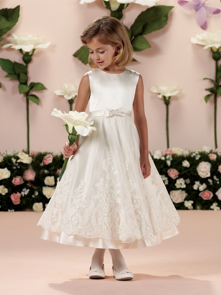 Calabrese Girl | Style No. › 114341 | Sleeveless satin and tulle tea-length A-line dress with jewel neckline, satin set-in waistband with center front bow, covered buttons down back bodice, tulle overlay skirt with wide lace appliqué and satin hemline, perfect as a flower girl dress or First Holy Communion dress. Also available in sizes 8 ½ – 14 ½ in White only. [...]