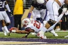 (Trent Nelson  |  The Salt Lake Tribune)   Utah Utes running back Devontae Booker (23) scores a touchdown as the University of Utah faces the University of Washington, NCAA football at Husky Stadium in Seattle, Saturday November 7, 2015.