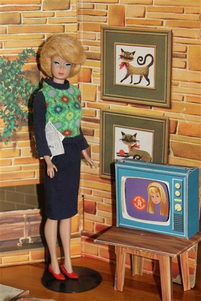 "Barbie, Knit Hit, # 1621 (1964) (Barbie is watch Skipper on her new color television! Who knew that Skipper was an actress? Maybe a guest spot on ""My Living Doll""?)"