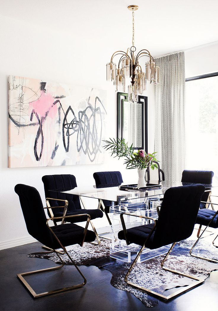 Black dining space with graphic modern art.