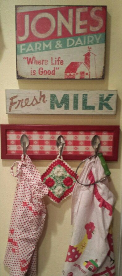 Bent spoons as hooks for vintage aprons, potholder, kitchenware. (House of Bliss Cozy Cottage - photo only)