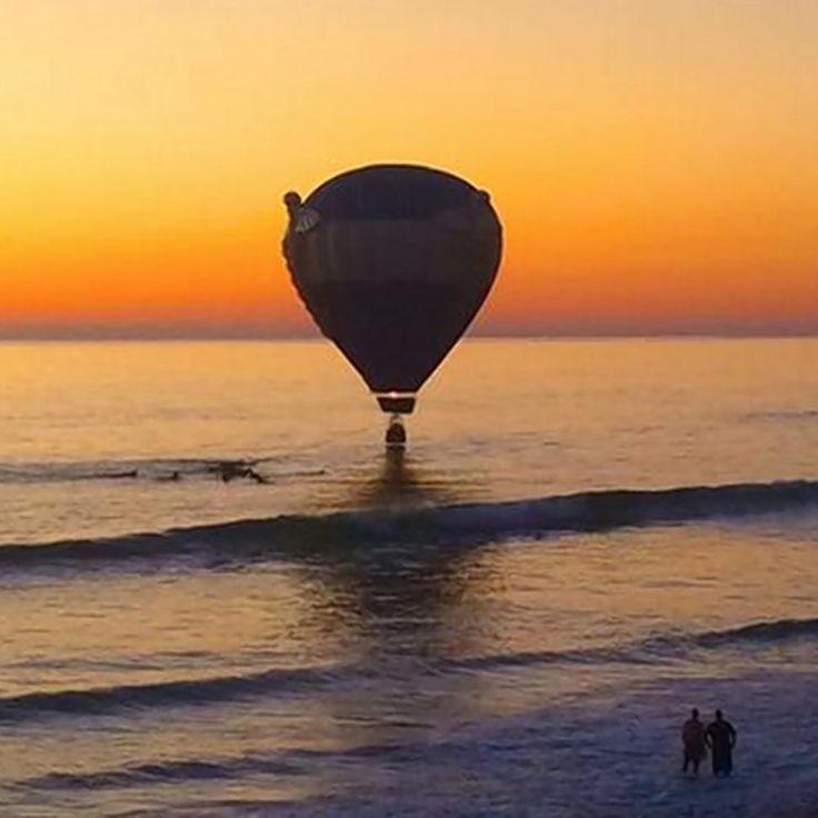 Hot air balloon surfs to safety Encinitas Cardiff beach CA