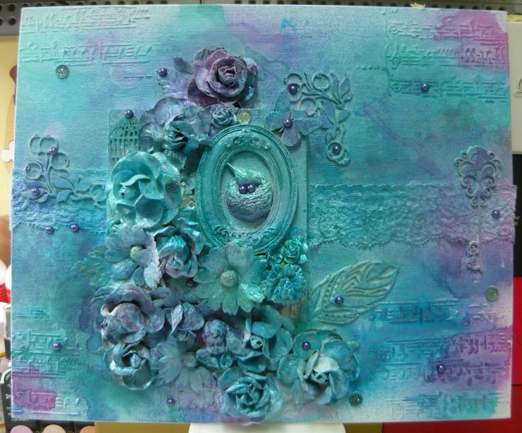 (by Lynne Nye, who said...)This is my first ever mixed media canvas using sprays and inks, I have been inspired by all the lovely canvases on Pinterest, There are lots on here from lace, flowers, resin, pearls, snip art the inks I sprayed with Cosmic shimmer and Cosmic shimmer vintage.