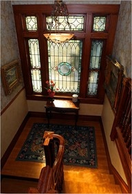 Stain glass at the front door to allow natural light in. Would like to do this to our front door when we own our own home.