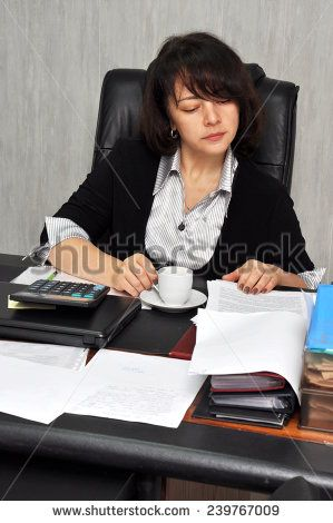 Beautiful executive woman working with documents in the office