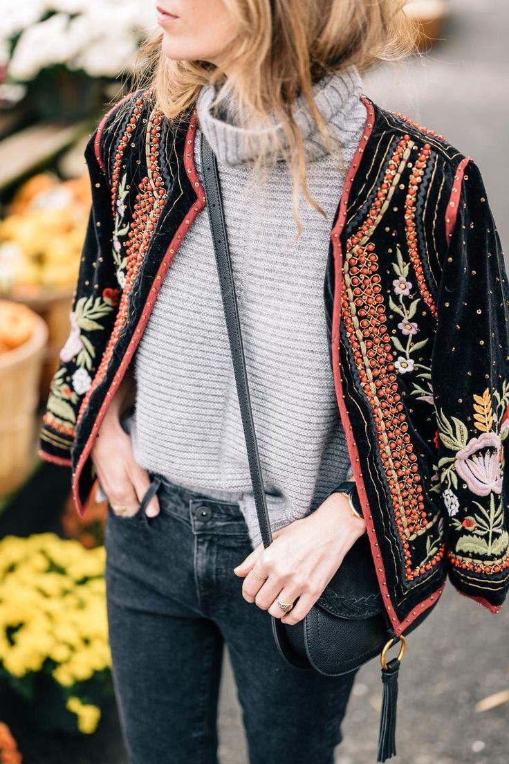 Jess Ann Kirby wears a Velvet Embellished Jacket and cashmere turtleneck sweater