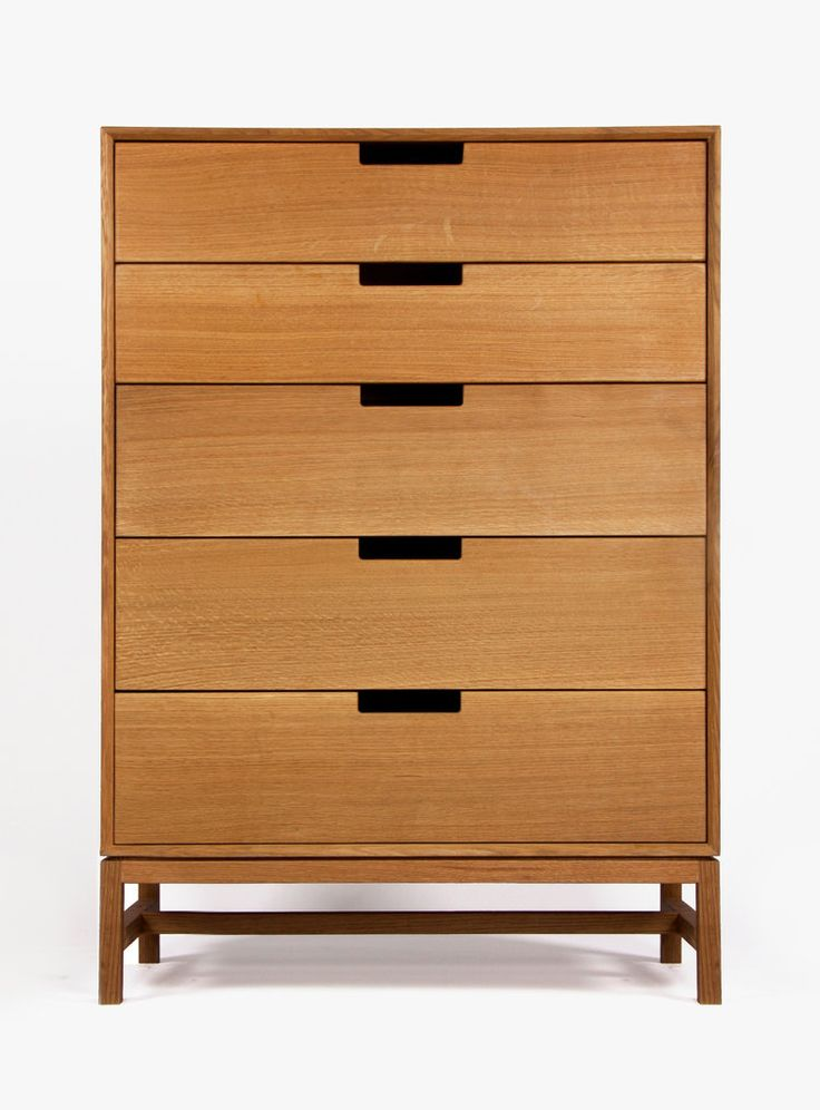 A contemporary tallboy dresser inspired by Mid-century Modern design.  Crafted from solid, American hardwood with a hand-rubbed, Danish oil and  wax finish. Available in custom dimensions and drawer configurations, as  well as in different wood types. Made in Chicago.