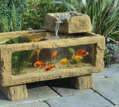 1000 images about above ground water garden features on for Above ground fish pond designs