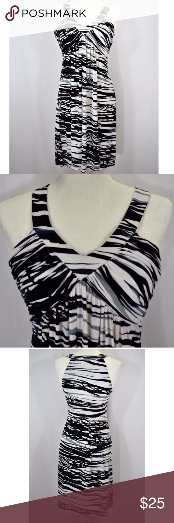 Beautiful Calvin Klein summer dress Gorgeous and flattering Calvin Klein summer dress🎀White, black, and gray pattern🎀Size 6🎀95% polyester and 5% spandex🎀Great condition-very gently used🎀Tag says dry clean, but I wash it on delicate and hang dry-I don't think that polyester needs to be dry cleaned!🎀There is a tiny spot that you can hardly see on the back.  I took a photo of it, but it is so small that it barely shows up.  I always disclose every little thing!🎀Smoke and pet free home…