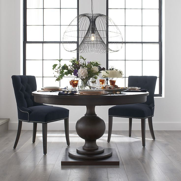 "Shop Winnetka 48"" Round Extendable Dining Table.   Sized for smaller rooms, the solid wood dining table seats four, expands to seat six with the leaf.  The Winnetka 48"" Round Extendable Dining Table is a Crate and Barrel exclusive."