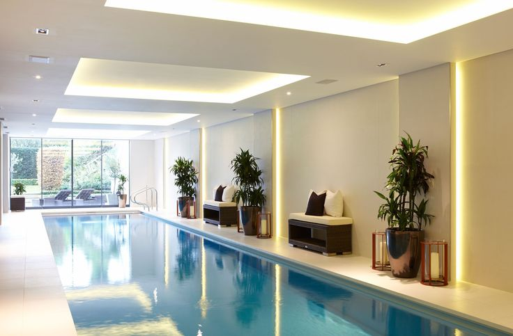 Indoor lap pool by Concept Bespoke Interiors