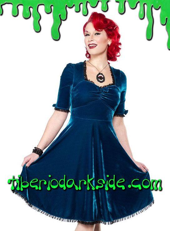 Vestido de terciopelo azul con escote fruncido, manga por el codo y ribete de tul negro con brillos. Material: 100% polyester. Marca: Sourpuss.  COLOR: NEGRO TALLA: L  L - 94 cm pecho (ES talla 40, MEX talla 30, UK talla 12)