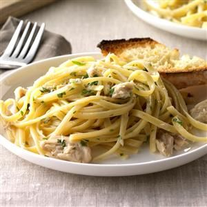 "Garlic Salmon Linguine Recipe -Theresa Hagan shares the garlic-seasoned main dish priced at 67 cents a serving. It calls for handy pantry ingredients, including pasta and canned salmon. ""I serve it with asparagus, rolls and fruit,"" says the Glendale, Arizona cook."
