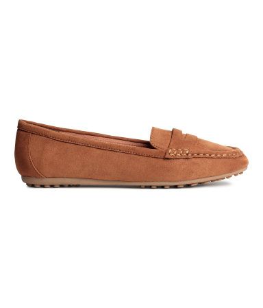 Loafers with a moccasin seam and strap at front. Fabric lining, imitation leather insoles, and rubber soles.