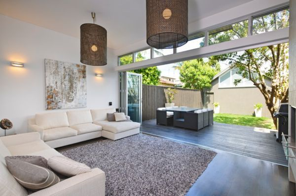 Use complimenting flooring between your living room and the outside to make the transition seamless, once your doors are opened.