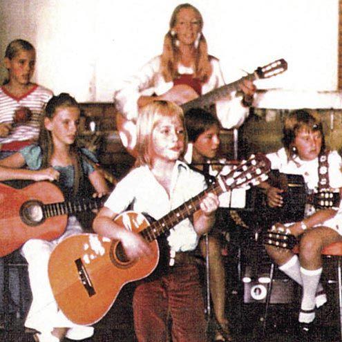 Little Keith strummin' his guitar(:
