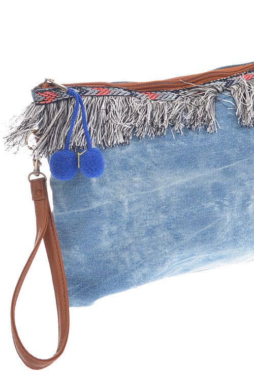 "Denim washed clutch with fringe and ball detail. 12W x 8 1/2""H Polyurethane, Mixed metals Available color: Dark Blue"