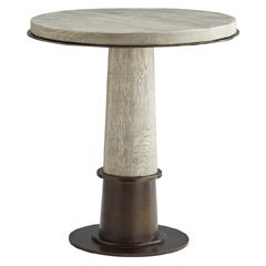 The Kamile side table from Arteriors expresses sleek, eclectic flair. On an iron base, solid oak forms an alluring tabletop. A distressed feel and natural iron accents complete the look. 24in Dia x 25in H. Oak, iron.