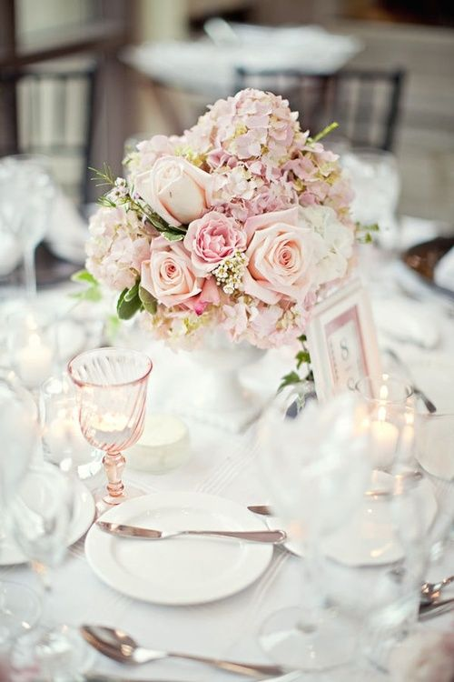 Centerpieces of blush hydrangeas and garden roses, perfect setting for a romantic wedding reception.  Beautifully photographed by Megan Thiele Studios
