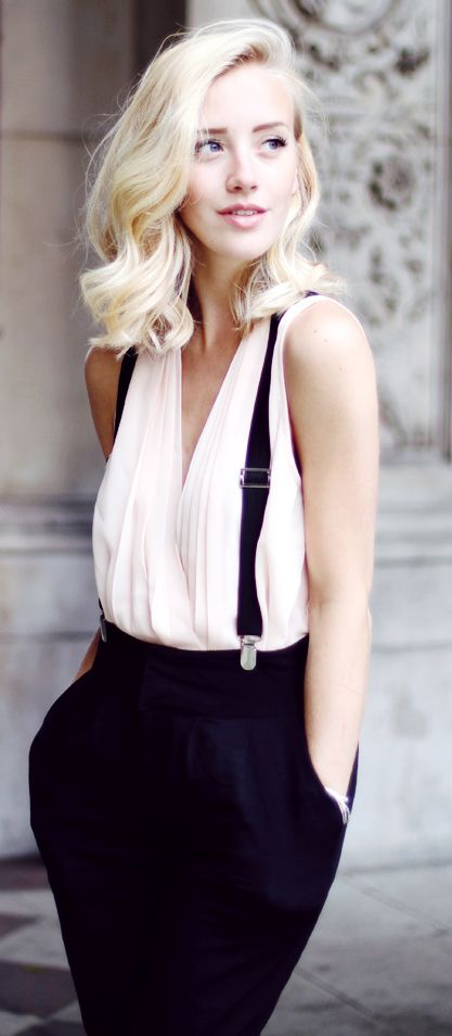 Suspenders. I can't tell if the shirt is white, off white, or a very pale pink. Could be the lighting as well.