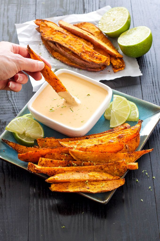 Chili Lime Sweet Potato Fries with Honey Chipotle Dipping Sauce | Healthier baked spicy sweet potato fries with a sweet and spicy dipping sauce! | @reciperunner