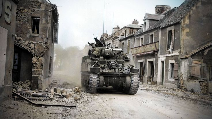 M4 Sherman tanks of the Sherbrooke Fusiliers advancing into Caen, Normandy. 10th July 1944.