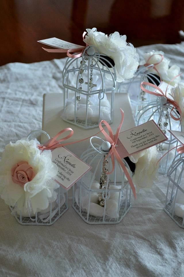 NATALIE - small birdcage bomboniere containing sugared almonds and a set of rosary beads, with flower and ribbon detail.