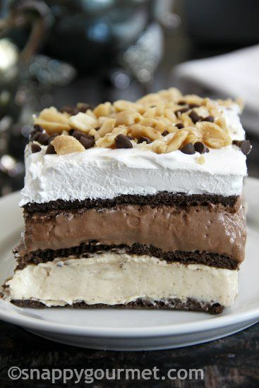 No-Bake Peanut Butter Chocolate Lasagna with instant chocolate pudding mix, vanilla pudding mix, chocolate graham crackers, peanut butter, milk, whipped topping, cream cheese, chocolate chips, and peanuts.
