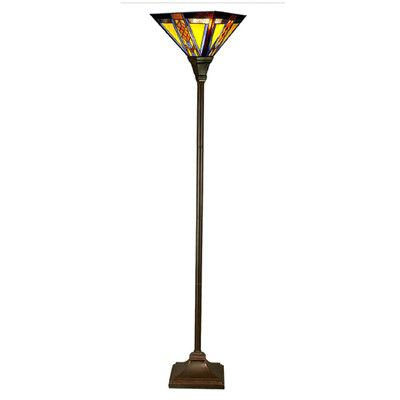 Southwestern Mission Style Stained Glass Floor Lamp from Wayfair. The Southwestern collection features a diamond and arrow pattern that runs through the center of each side. The colors are warm with a cool stripe of blue. This shade alternates smooth and textured glass. The base is sleek with concave platform and torch.