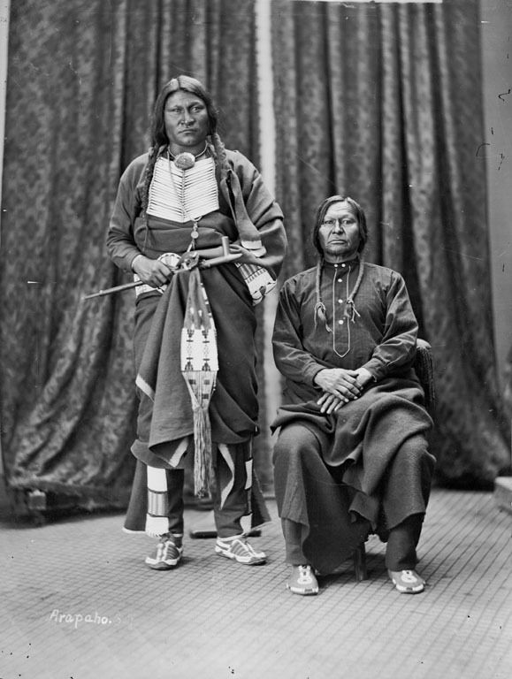 Portrait of Friday and Crazy Bull, Arapaho, Both in Partial Native Dress, One Holding Pipe and Bag - Gradner -1873