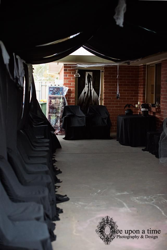 The party area, enclosed in black cloth. Hired chairs with black covering.