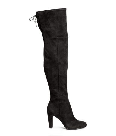 Black. Thigh-high boots in imitation suede. Soft leg section with slit and lacing at top, half zip, and rubber soles. Heel height 3 1/4 in.