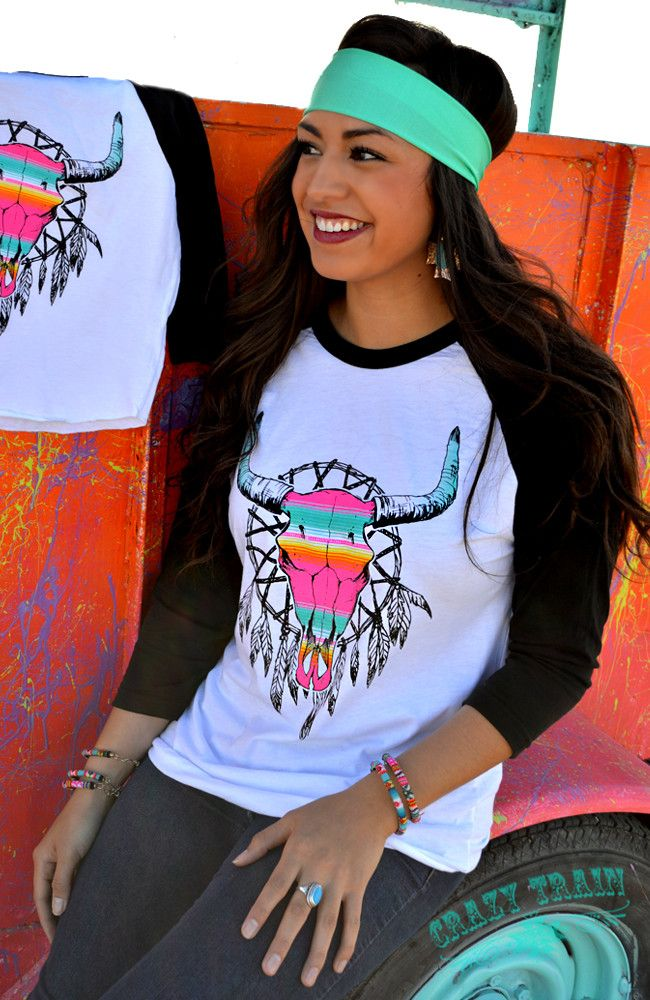 We're lovin' this new line from Crazy Train! Jump on board with our 'Neon Western Dreamin' baseball tee. Beautifully colorful neon steer skull, serape style in dreamcatcher. Trendy southwest style. 3/