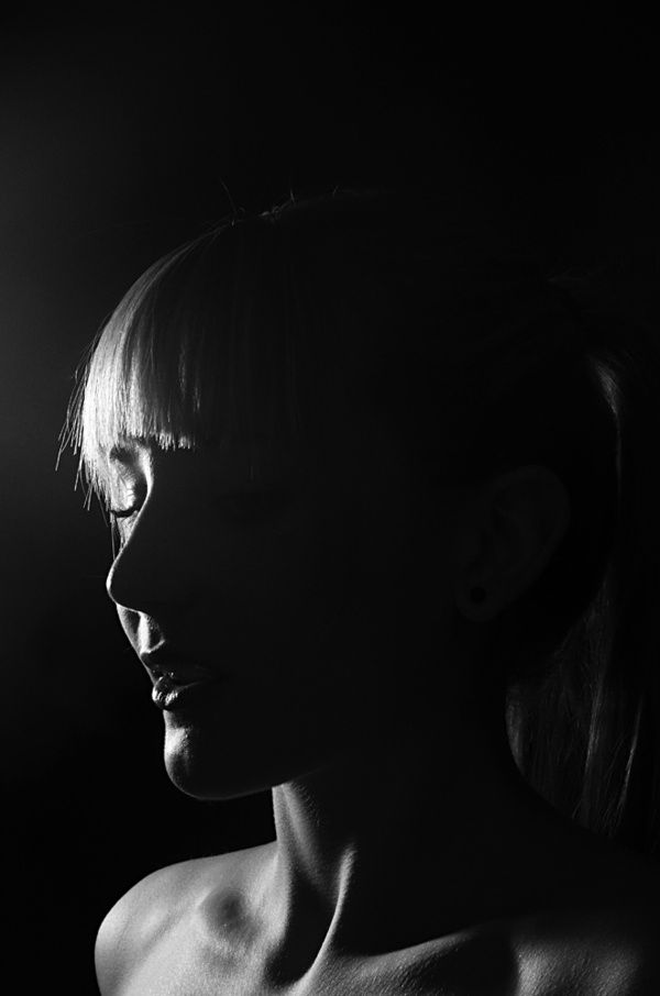 What stunning light! More Daniel Reuber. minimal monochrome fashion photography dark blackandwhite female portrait