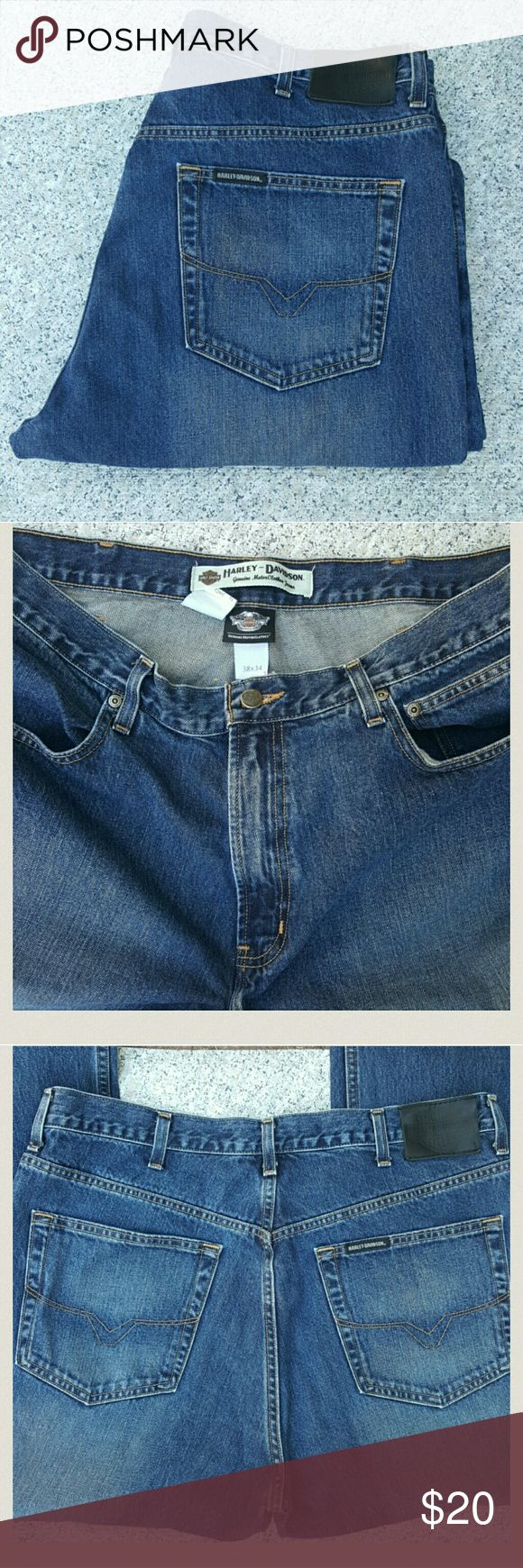 Genuine Harley Davidson Jeans Excellent condition, they look practically new!! Genuine Harley Davidson, 100% cotton features a dark slightly tinted wash with distressed sandblasting on thighs. Slight taper to the ankle and still fits nicely over your riding boots. 38×34 classic 5 pocket style jeans sits at the natural waist, slimmer fit through seat and thighs. Embossed Bar & Shield leather patch at back waist.      These jeans are in great condition and comes from a smoke free home…