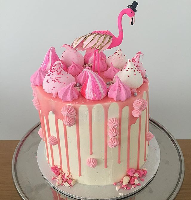 Flamingo cake.Layers of vanilla bean butter cake and chocolate fudge cake, vanilla bean Swiss meringue buttercream, fresh strawberries and topped with a chocolate drip and meringue kisses. Happy 2nd birthday little Rita