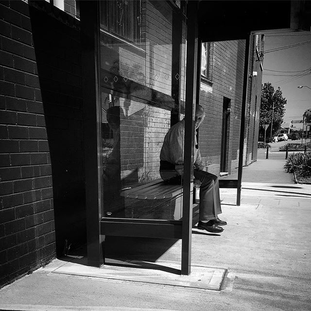 'Shadows under the feet'   Waiting for the Bus   Haberfield, Sydney   photo @rajsuri   2016  #street #documentary #bw #photojournalism #streetphotography #life #society #people #culture #humanity #film #reportage #story #photooftheday #rajsuri #local #Australia #director #multicultural #everydayaustralia #indie #Magnumphoto #lensculture #busstop #footpath #diversity #senior #mature
