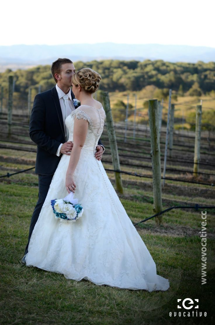Bride and Groom in the vineyard at Woodlands of Marburg. #WeddingPhotography