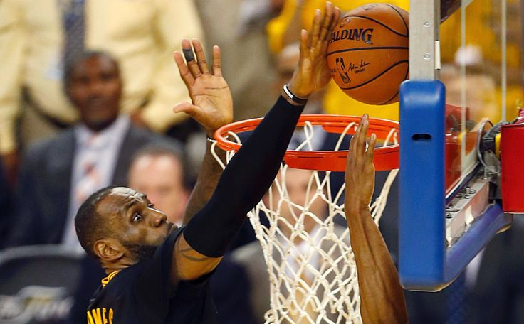 Cleveland Cavaliers forward LeBron James (L) blocks a shot by Golden State Warriors Andre Iguodala during the fourth quarter in Game 7 of the NBA Finals on June 19, 2016 in Oakland, California. Powered by an amazing effort from LeBron James, the Cleveland Cavaliers completed the greatest comeback in NBA Finals history, dethroning defending champion Golden State 93-89 to capture their first NBA title.
