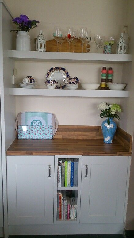 My old kitchen units painted in pearl grey, new counter top and floating shelves.