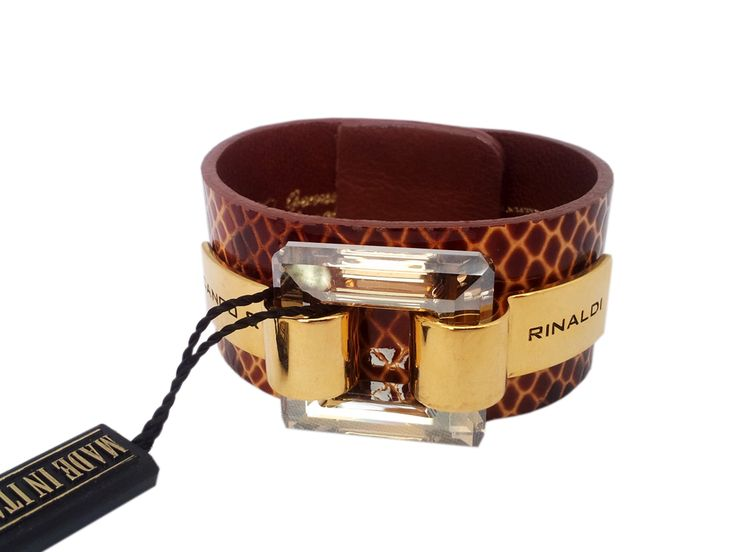 Cango & Rinaldi darker brown leather bracelet with yellow lines and Swarovski crystals has been very popular. Golden metal parts bring contrast to the whole as big clear Swarovski crystal fulfills the combination.