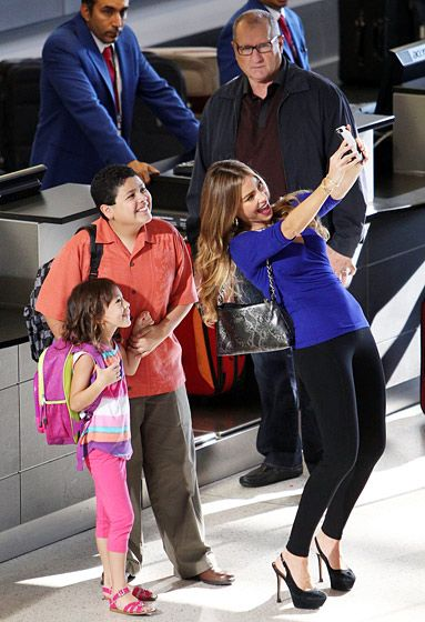 Sofia Vergara snaps a selfie while on the set of Modern Family