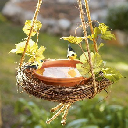 Easy Wreath Birdbath/Feeder  3/8-inch manila rope   15-inch grapevine wreath   10-inch terra-cotta saucer   Artificial grape leaves (optional; available at craft stores)   Total Time Needed: 30 Minutes or less   Instructions    Cut three (5-foot) lengths of rope and knot them together at both ends. Nestle the wreath inside the ropes, as shown.