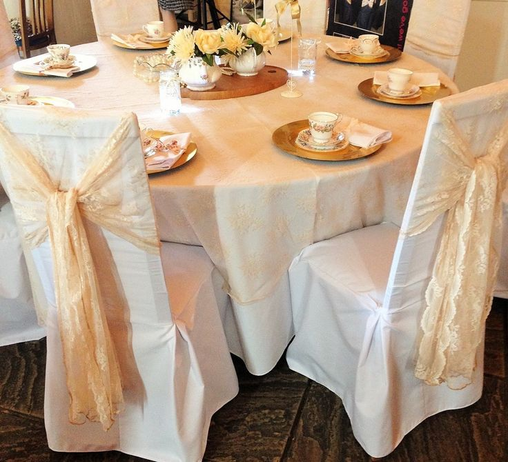 Antique Lace chair sashes on white cotton chair covers from Simply Bows and Chair Covers at Ufton Court