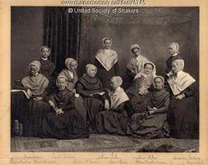 Shaker women in traditional 19th century clothing