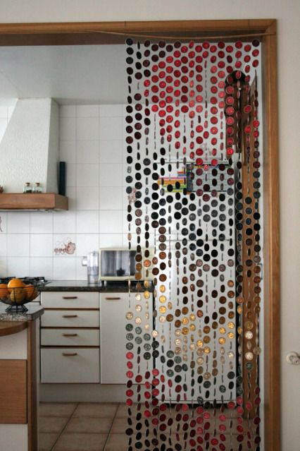 Nespresso coffee capsules curtains: DIY (this could also work w/pounded beer bottle caps)